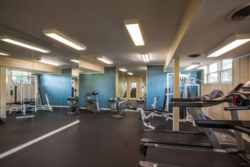 Fitness center with mirrored walls and workout equipment